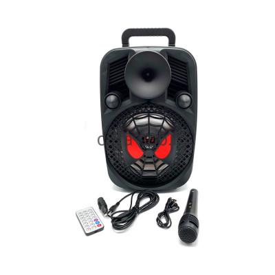 Беспроводная колонка DG-1028 + проводной микрофон черный купить оптом | cifra-spb.ru